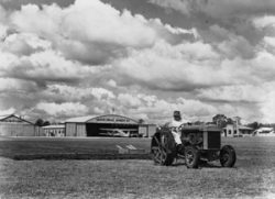 Aerodrome Control Officer Andrew Veitch Lauchland mowing the field of Brisbane's aerodrome.